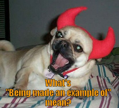 pug wearing devil horns
